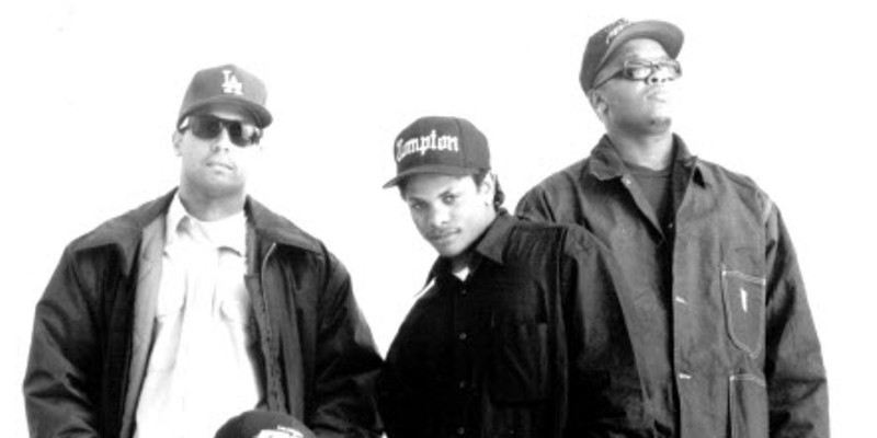N.W.A after Ice Cube left the group. From left to right: Yella, MC Ren (crouching), Eazy-E, and Dr. Dre.