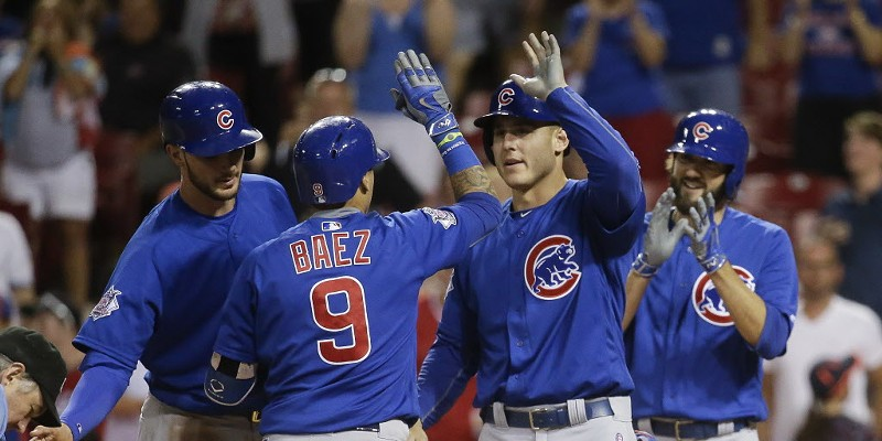 A 15th-inning grand slam by Javier Baez helped the Cubs win Tuesday night, as did three pitchers who played left.