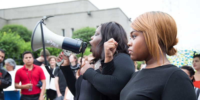 Chicago activists shut down Dan Ryan Expressway during police brutality protest #ChiCallToAction Protest organizers (L) Imani and Kristen giving safety instructions before the march, showing how to lock arms so that the police can not easily break the group apart. Sunshine Tucker