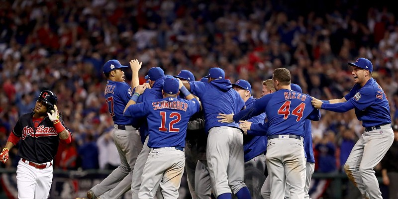 The Cubs celebrate after the last out Wednesday night.