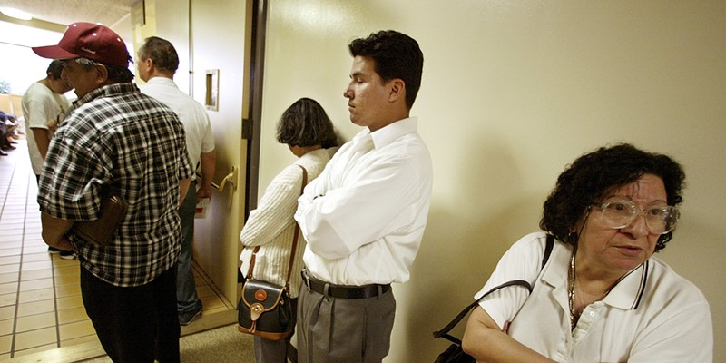 Patients wait in line for treatment at a California clinic.