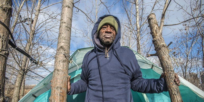 "Home sweet home for the homeless Terry, 59, was one of the last people to leave Rezkoville after security guards gave numerous warnings that the land would be cleared for development. With a patched-up tent, a plastic chair, candy canes hanging from the trees, a gate woven from branches, and a fire burning even in summer, this is where Terry felt at home. ""Terry, he just won't leave!"" says his friend Allan, who used to venture into Rezkoville to check on him even after the area was cordoned off."