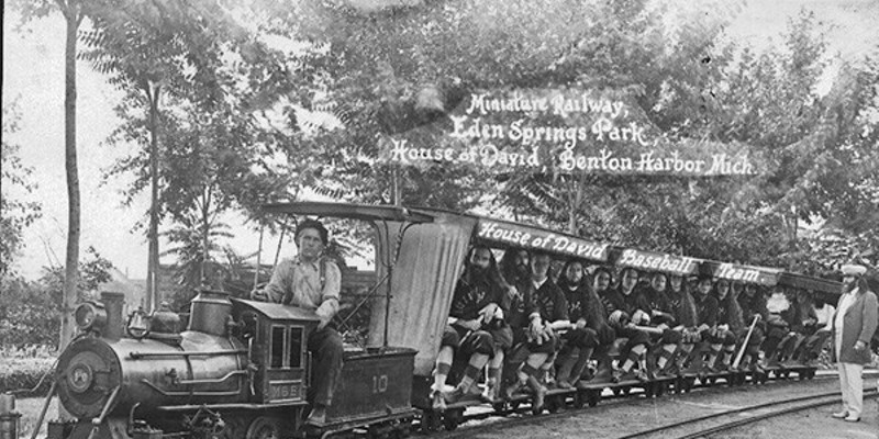 House of David baseball team members aboard a miniature train
