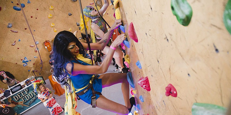 Abhijeet Rane, 24, and Jforpaydotcom, 25, race to the top of the wall as other drag artists cheer them on at Brooklyn Boulders.