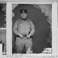 The Contract Buyers League strikes back A sheriff's deputy guards a home on South Emerald Avenue where police had smashed windows during an eviction and used a chemical spray on eight people who'd barricaded themselves inside the home. Sun-Times print collection