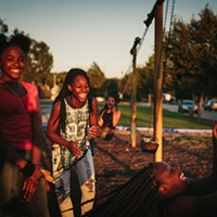 "An East Chicago community dissolves in the fallout from a decades-long lead crisis Friends since childhood, Janae Peyton, 13, Ashanti France, 12, Irene Wooley, 13, and Tniyah Foxx, 12, swing at a park at the former Carrie Gosch Elementary School, which was turned into an EPA office. After elevated lead levels were found in a far corner of the school grounds, administrators moved students to the former West Side Middle School. ""All my memories are here,"" Peyton says. ""I've got to move away from my friends."""
