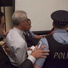 Police  escorted Emanuel out of a budget hearing last night after protesters took over the stage.