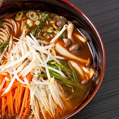 Lamian (a type of hand-pulled noodle) with spicy miso broth, bean sprouts, and enokitake and shimeji mushrooms