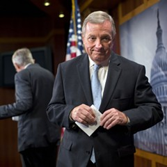 Senator Dick Durbin leaves the stage after answering questions about Democrats protecting President Obama's Iran deal
