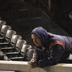Rain fell at Wrigley Tuesday night, but that didn't ruffle the Mets, either.