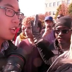 "Janna Basler, right, who works in the University of Missouri's office of Greek life, tells photographer Tim Tai, to ""leave these students alone"" in their ""personal space."""