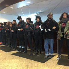 "BYP 100 protesters wore sweatshirts emblazoned with the phrase ""Fund Black Futures"" during Saturday's shutdown of a police-affiliated credit union."