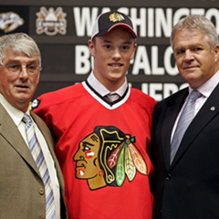 Jonathan Toews poses for a photo with Chicago Blackhawks officials after being selected third overall in the 2006 NHL Draft in Vancouver.