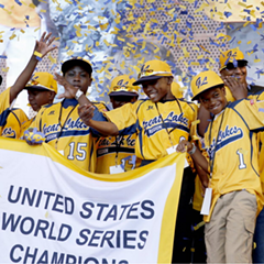 The Jackie Robinson West All Stars Little League baseball team celebrates its 2014 Little League Championship. The team was later stripped of its title.
