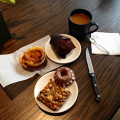 Coffee and pastry at Loba (clockwise from left): ham and cheese kouign amann, chocolate cardamom muffin, Robbie, pepita crunch bar.