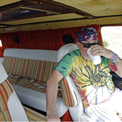 Cubs manager Joe Maddon sits in his van before a late-February practice session.