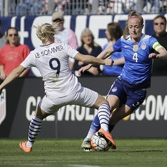 Becky Sauerbrunn, right, faces off against French  forward Eugenie Le Sommer during a SheBelieves Cup  match March 6 in Nashville.