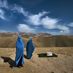 In Afghanistan, a stranded village woman and her pregnant daughter desperately try to find a ride to a clinic.