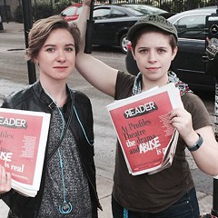 Actors hand out copies of the Reader in front of Profiles Theatre