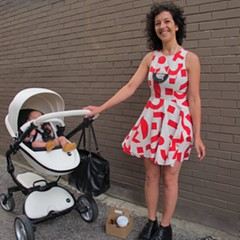 A mother and her new daughter show off their stylish outfits.