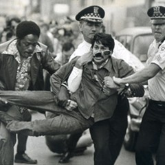 A demonstrator is arrested in front of the Medinah Temple on June 14, 1977, while anti-gay crusader Anita Bryant gives at a concert inside.