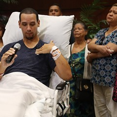 Orlando shooting survivor Angel Santiago points to the spot where his friend was shot in the chest as he speaks to the media from a Florida hospital Tuesday.