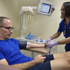 A technician prepares to take a blood donation at a clinic in Orlando.