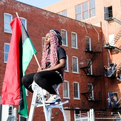 One activist arrested Wednesday during police divestment protest and party