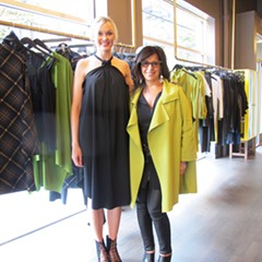 Maria Pinto (right) stands next to one of her models, who's wearing a prefall halter-neck trapeze dress.