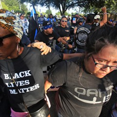 Supporters of the 'Blue Lives Matter' movement, back, and supporters of the Black Live Matter movement, front, held opposing rallies in McAllen, Texas, in mid-July.