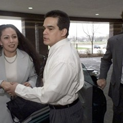 Rolando Cruz, center, in front of the DuPage County Courthouse in 1999