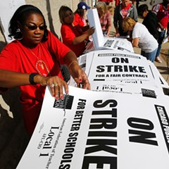 Retired teacher Patricia Lofton counted a stack of picket signs Monday as the Chicago Teachers Union and Chicago Public Schools worked to avoid a strike.