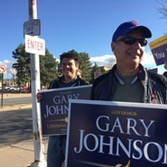Libertarian Party presidential nominee Gary Johnson joins sign-waving supporters in Santa Fe, New Mexico, Tuesday.