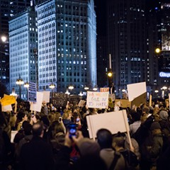 Protesters gather across the river from Trump Tower on the night of November 9.