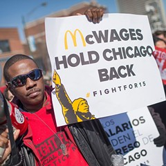 Demonstrators demanding an increase in the minimum wage protest in front of a Chicago McDonald's in April.