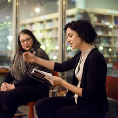Emily Lordi (right) reads from her book on soul singer Danny Hathaway during a discussion with Tara Betts at the Seminary Co-op.