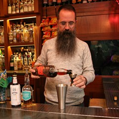 Paul McGee pours OFTD rum to make a cocktail