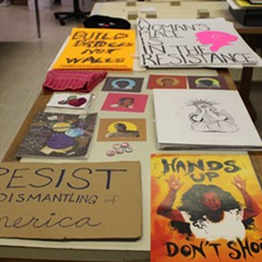 A selection of materials from the Women's March that have been collected by the Newberry Library