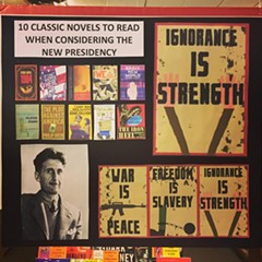 A placard in Lakeview's Unabridged Bookstore suggests a host of classic dystopian novels for this political moment.