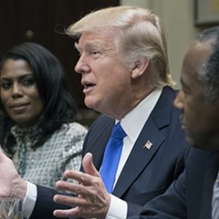 President Donald Trump, center, with Omarosa Manigault, left, and Ben Carson, right, during his Black History Month listening session last week.