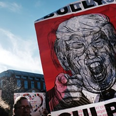 Protesters critical of President Donald Trump attended a rally and general strike in New York's Washington Square Park Friday.