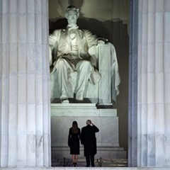 Then President-elect Donald Trump and wife Melania gaze up at the Lincoln Memorial on the eve of Trump's January Inauguration.