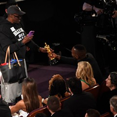 Mahershala Ali, right, hands his award for best supporting actor to a tourist named Gary during the Oscars Sunday night.