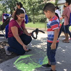 Ana Correa draws with her son Bylan at a CPS back-to-school celebration in August 2016.