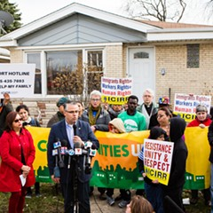 Thirty-sixth Ward alderman Gilbert Villegas speaks at a gathering of Belmont Cragin residents Tuesday, demanding an investigation into the shooting of a 53-year-old man shot in his home by federal immigration agents.
