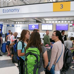 Customers wait in line in United Airline's Terminal 1 at O'Hare International Airport in 2015.