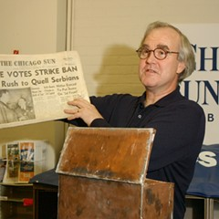 Former Chicago Sun-Times publisher John Cruickshank, shown here in 2004, holds up a copy of the first edition of the Chicago Sun newspaper, dated December 4, 1941.