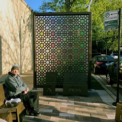 """A seating area off Devon with a """"gateway screen"""" inspired by Islamic architecture."""