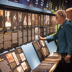 Cook County Board president Toni Preckwinkle checks out the exhibits at the American Writers Museum with the museum's director of operations, Christopher Burrow.