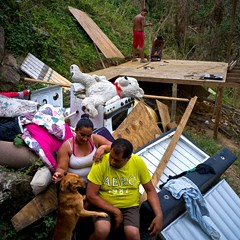 Yadira Sortre and William Fontan Quintero pose next to what is left of their belongings, destroyed by Hurricane Maria, in the San Lazaro neighborhood of Moravis, Puerto Rico.